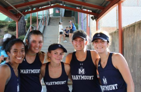 Seniors on the Marymount Varsity tennis team celebrate a massive defeat against Beverly Hills High School at the beginning of the season. They will be dearly missed next year!