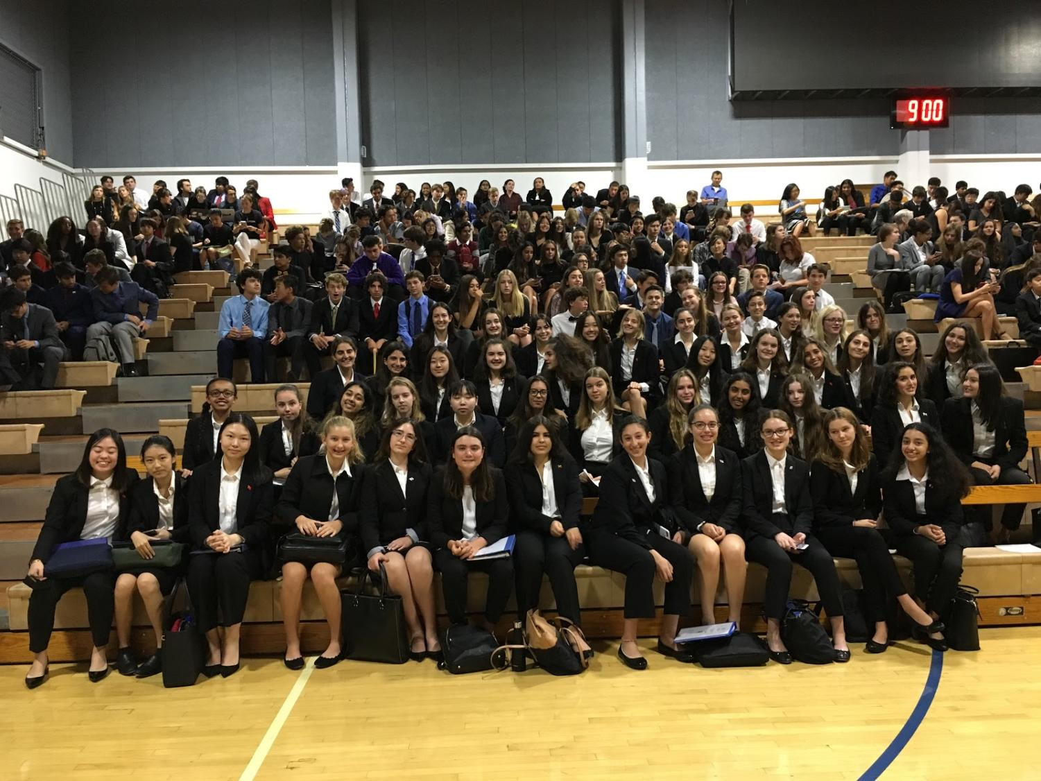 Marymount High School students that participated in Santa Margarita's annual Model United Nations conference sitting together in the gym before the Opening Ceremony begins.