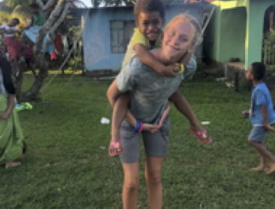 Junior Brooke Pierpoint and her new friend Taru. She is hosting an afternoon kids club for the children of Momi village. Taru and Brooke became instant friends. Brooke taught her English and American games.