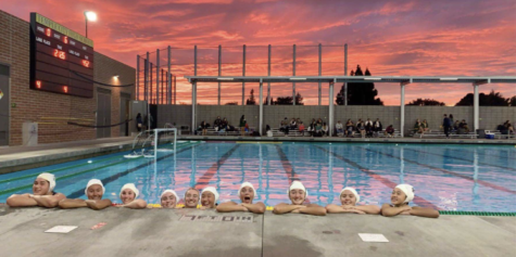 The water polo team celebrates a respetable game with the beautiful sunset. Courtesy of Sophia Baumann '23