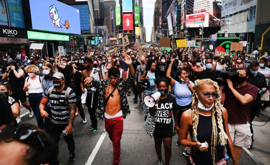 NEW YORK, NEW YORK - AUGUST 24: Protesters with the Black Lives Matter (BLM) movement march through Manhattan following the shooting of a Black man by a White police officer in Kenosha, Wisconsin over the weekend, on August 24, 2020 in New York City. The Wisconsin National Guard has been deployed to Kenosha after the man was shot several times at close range in the back during an encounter with a police officer, which was caught on video.  (Photo by Spencer Platt/Getty Images)