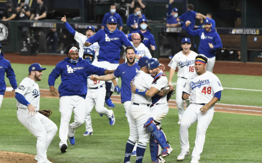 Dodger players swarm the field celebrating their victory over the Tampa Bay Rays in the final game of the World Series. Photo Courtesy of the Los Angeles Times.