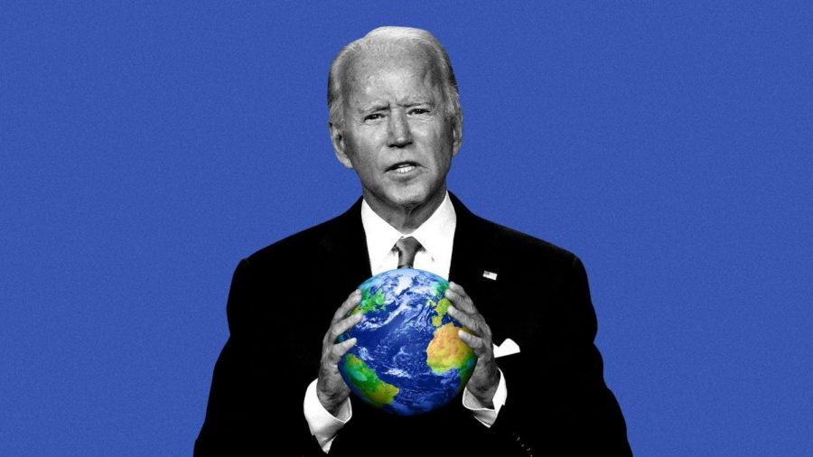 President Joe Biden holding a globe, symbolizing his  effort to fight climate  change.