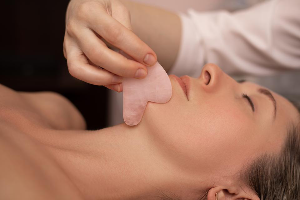 The ancient Chinese practice of gua sha has been popularized as a way of slimming or shaping the face. (Photo courtesy of Forbes)