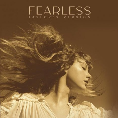 An adult Taylor recreating her 2008 album cover with the similar golden vibe emanating from the photo (https://www.clashmusic.com/reviews/taylor-swift-fearless-taylors-version).